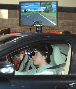Student behind the wheel of the Driving Simulator - goggles (HMD) head shot