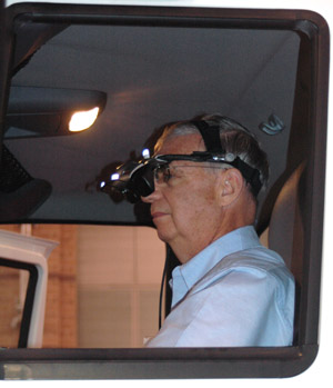 Driver in International Truck Driving Simulator Behind the Wheel - goggles (HMD) head shot